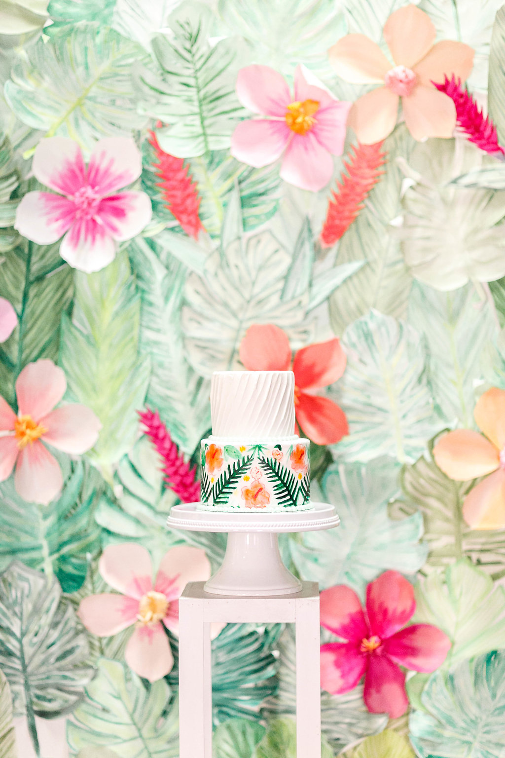 floral cake table backdrops - photo by Virginia Ashley Photography http://ruffledblog.com/modern-industrial-wedding-inspiration-with-tropical-vibes
