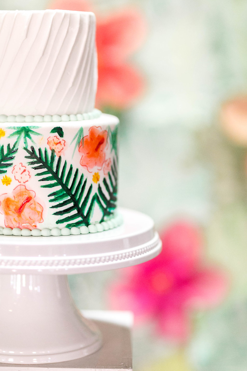 tropical floral wedding cakes - photo by Virginia Ashley Photography http://ruffledblog.com/modern-industrial-wedding-inspiration-with-tropical-vibes