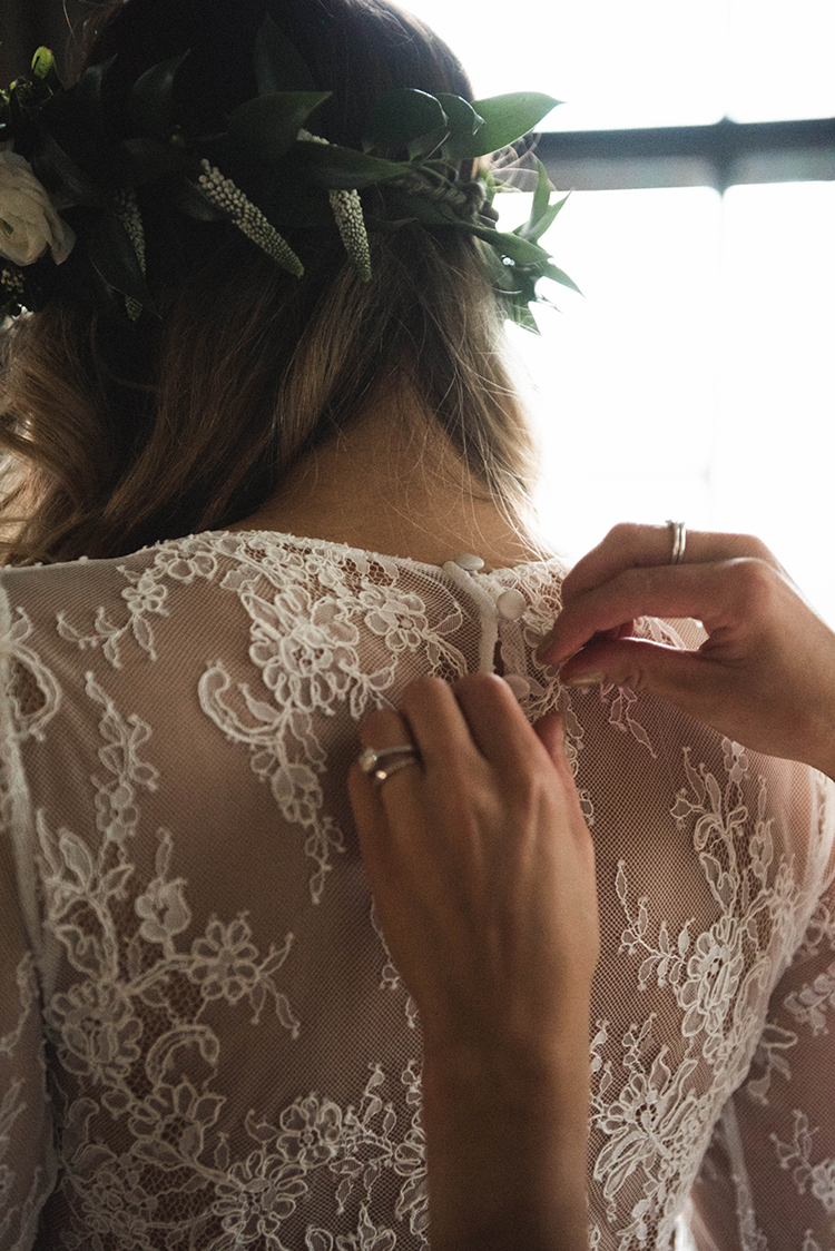 bride getting ready - photo by A Sea of Love http://ruffledblog.com/modern-industrial-wedding-with-lots-of-greenery