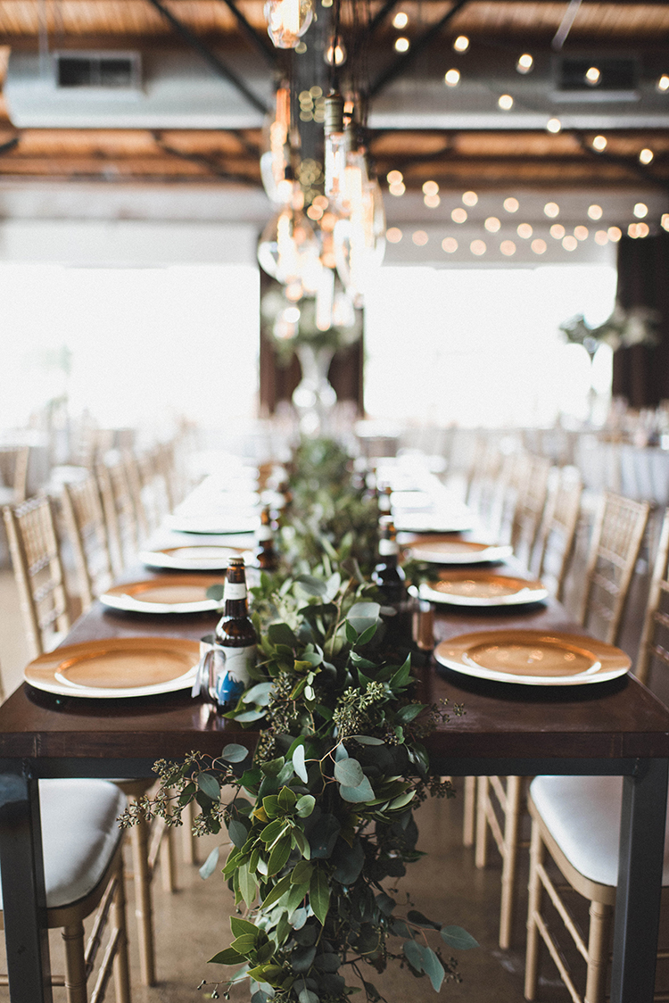 greenery table runners - photo by A Sea of Love http://ruffledblog.com/modern-industrial-wedding-with-lots-of-greenery