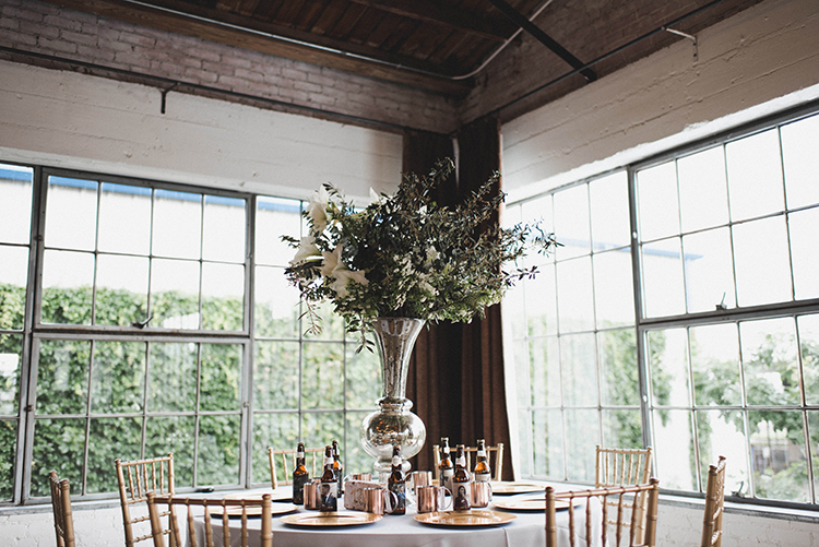 wedding receptions - photo by A Sea of Love https://ruffledblog.com/modern-industrial-wedding-with-lots-of-greenery