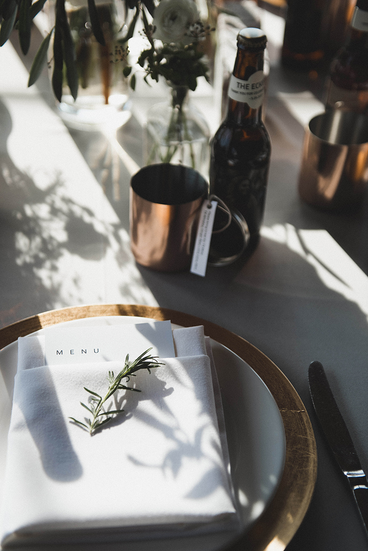 wedding tables with metallics - photo by A Sea of Love http://ruffledblog.com/modern-industrial-wedding-with-lots-of-greenery
