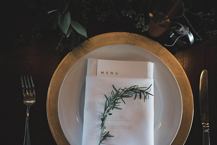 metallic place settings - photo by A Sea of Love http://ruffledblog.com/modern-industrial-wedding-with-lots-of-greenery