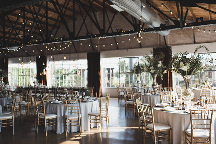 industrial romantic wedding receptions - photo by A Sea of Love https://ruffledblog.com/modern-industrial-wedding-with-lots-of-greenery
