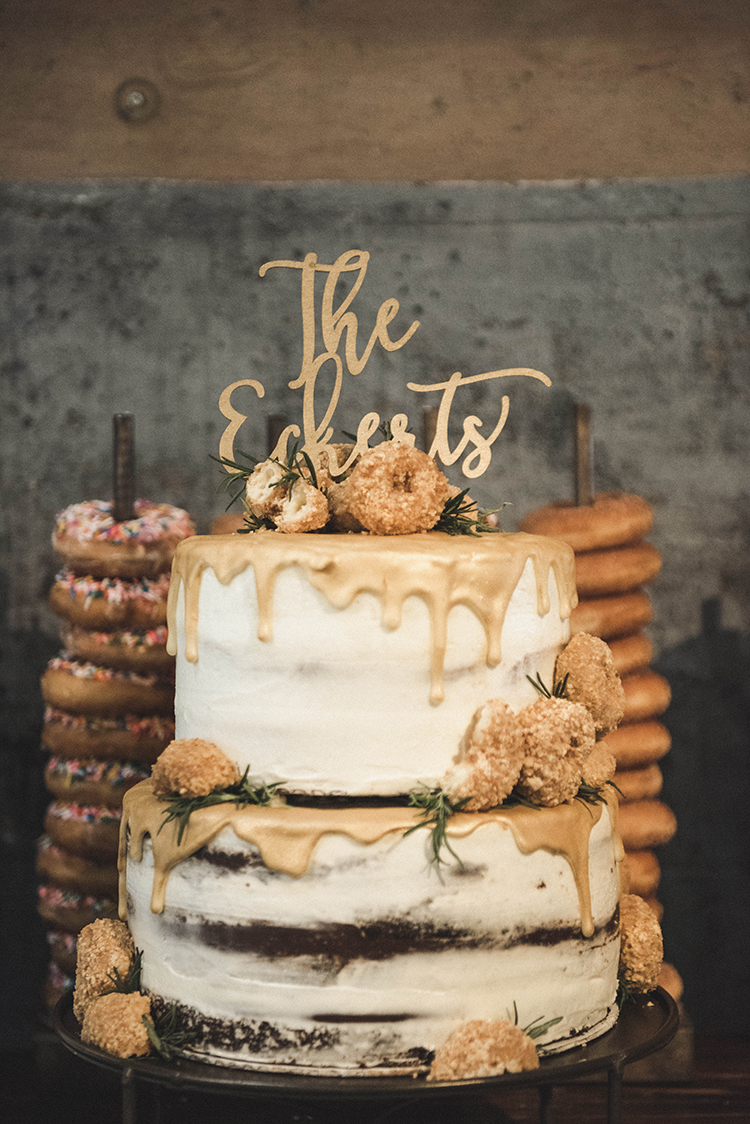 wedding cakes with donuts - photo by A Sea of Love https://ruffledblog.com/modern-industrial-wedding-with-lots-of-greenery