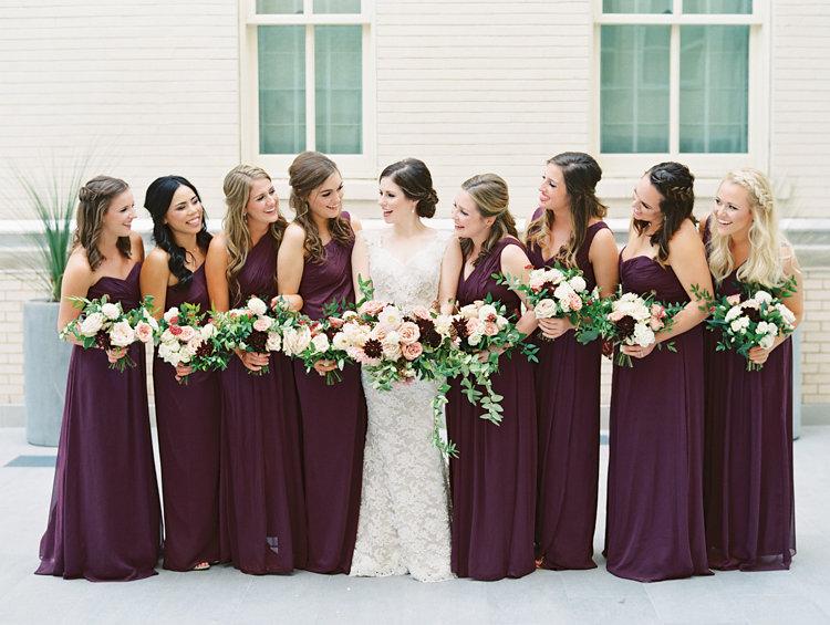 burgundy bridesmaid dresses - photo by Bethany Erin Photography http://ruffledblog.com/modern-meets-rustic-wedding-in-dallas