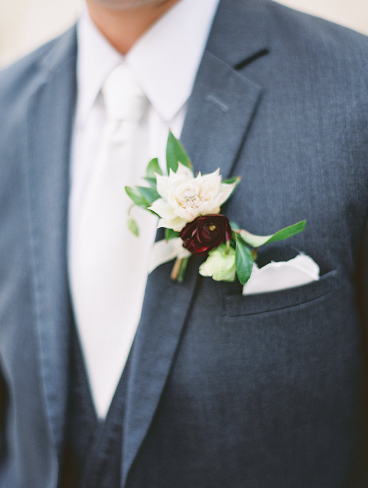 grooms boutonniere - photo by Bethany Erin Photography http://ruffledblog.com/modern-meets-rustic-wedding-in-dallas