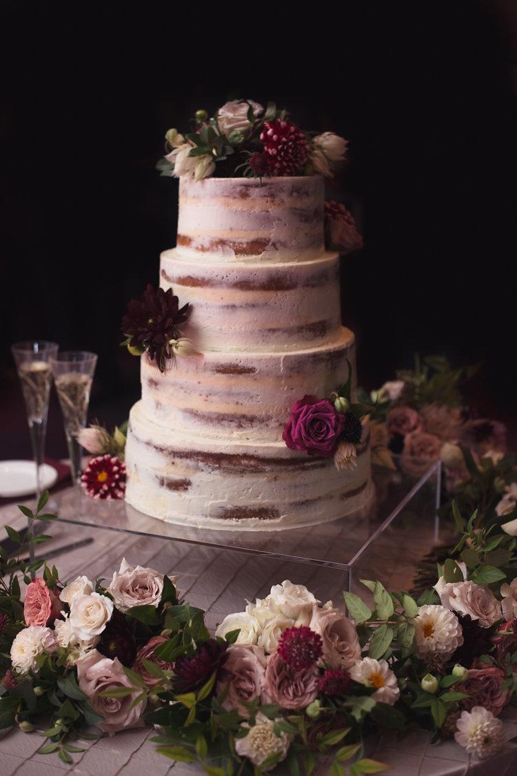 lightly iced wedding cakes - photo by Bethany Erin Photography http://ruffledblog.com/modern-meets-rustic-wedding-in-dallas