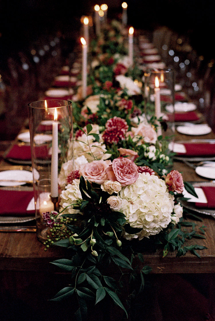 floral table runners - photo by Bethany Erin Photography http://ruffledblog.com/modern-meets-rustic-wedding-in-dallas