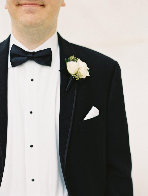 black tie wedding boutonnieres - photo by Abby Jiu Photography http://ruffledblog.com/modern-metallics-wedding-in-downtown-washington-dc