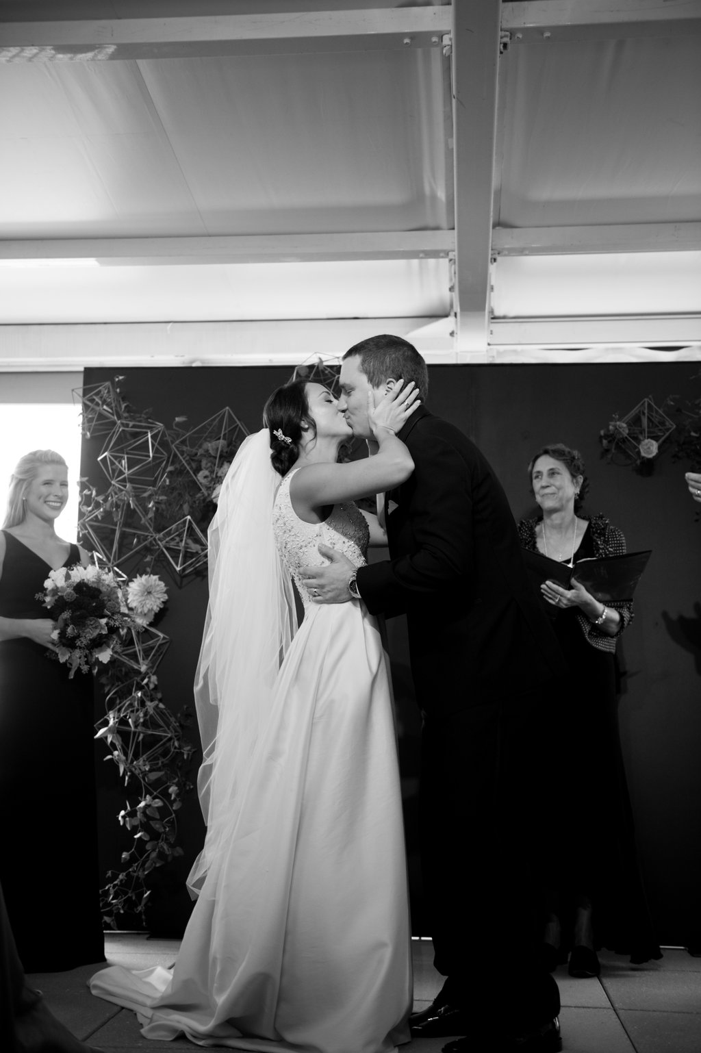 ceremony kiss - photo by Abby Jiu Photography http://ruffledblog.com/modern-metallics-wedding-in-downtown-washington-dc