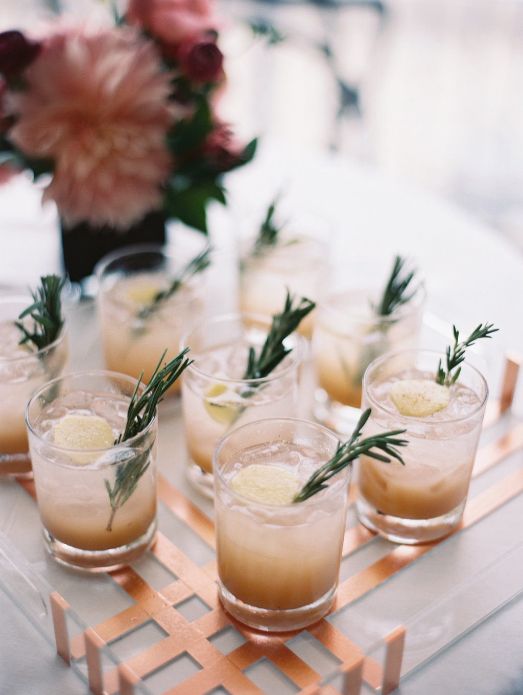 wedding cocktails with rosemary - photo by Abby Jiu Photography https://ruffledblog.com/modern-metallics-wedding-in-downtown-washington-dc