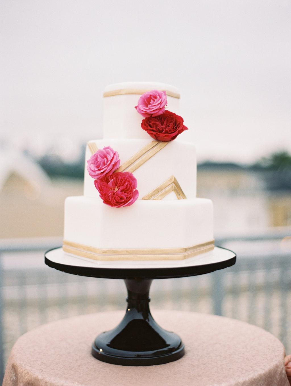 white and gold wedding cakes - photo by Abby Jiu Photography http://ruffledblog.com/modern-metallics-wedding-in-downtown-washington-dc