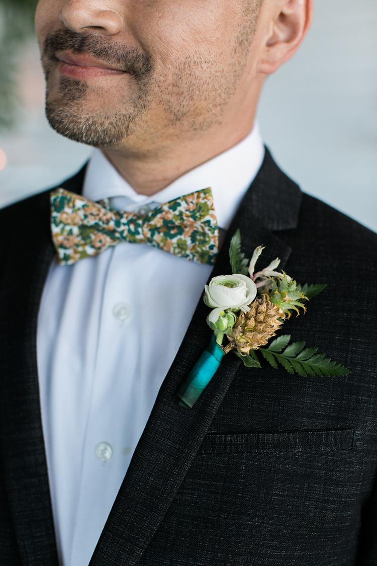 colorful groom boutonnieres - photo by J Wiley Photography http://ruffledblog.com/modern-minimalist-wedding-ideas-with-a-tropical-twist