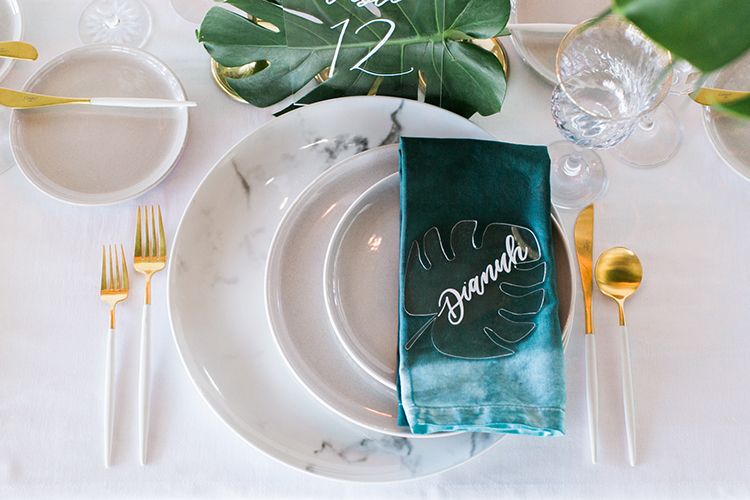 wedding place settings with dip dyed napkins - photo by J Wiley Photography https://ruffledblog.com/modern-minimalist-wedding-ideas-with-a-tropical-twist
