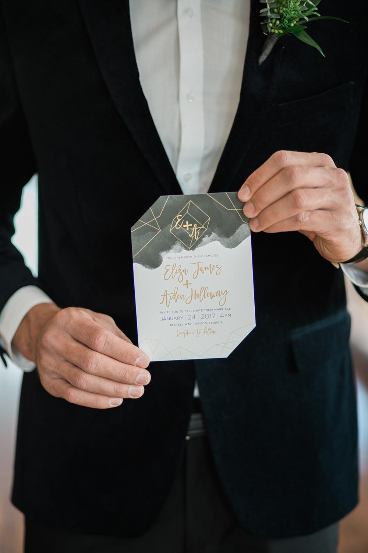 black and gold paper goods - photo by Kristen Weaver Photography https://ruffledblog.com/modern-organic-wedding-inspiration-with-greenery
