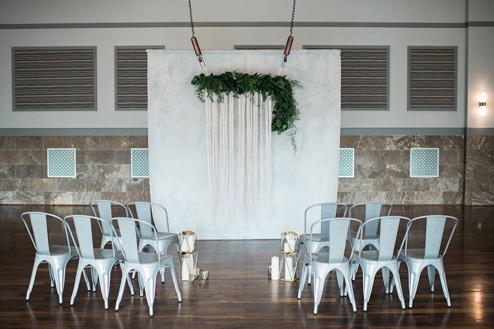 wedding ceremony decor - photo by Kristen Weaver Photography http://ruffledblog.com/modern-organic-wedding-inspiration-with-greenery