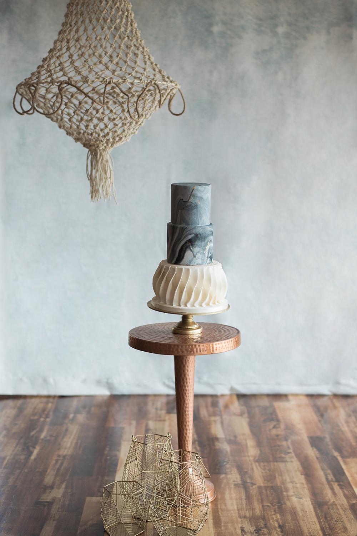 wedding cake tables - photo by Kristen Weaver Photography https://ruffledblog.com/modern-organic-wedding-inspiration-with-greenery
