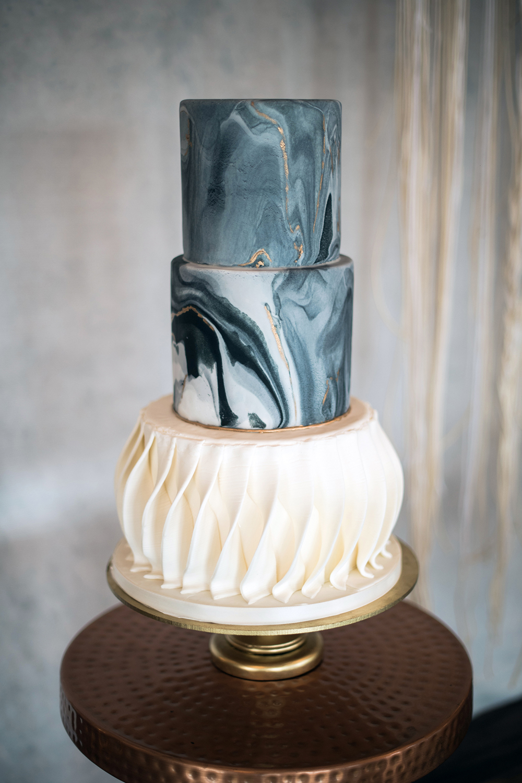 unique marbled wedding cakes - photo by Kristen Weaver Photography https://ruffledblog.com/modern-organic-wedding-inspiration-with-greenery