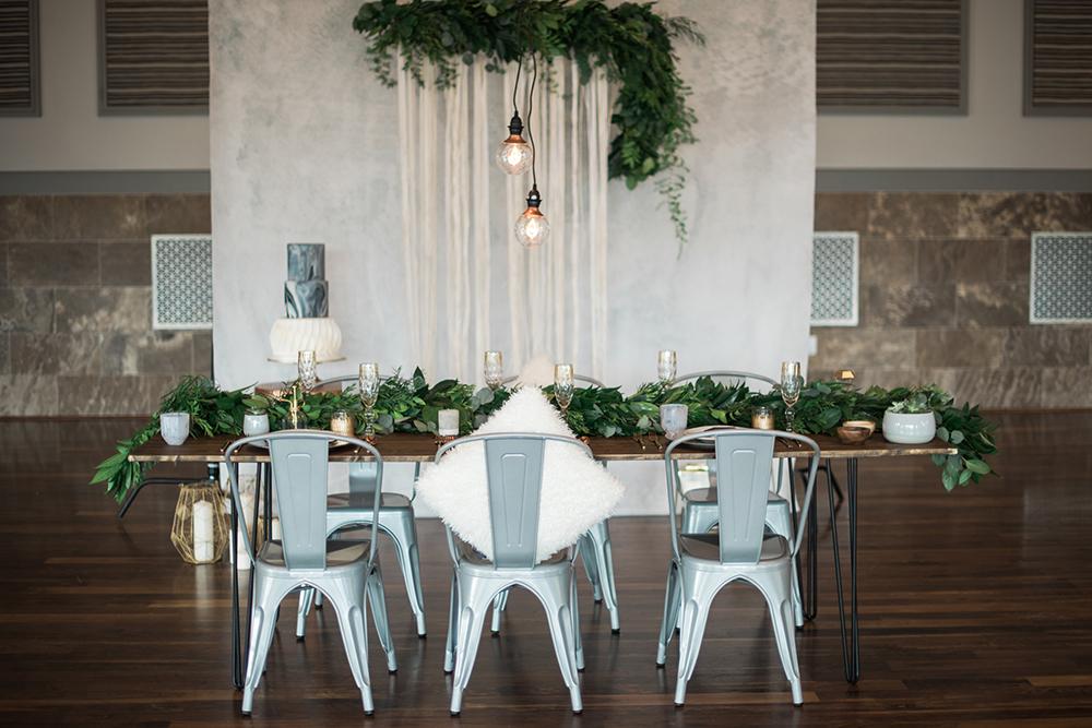 wedding tablescape ideas - photo by Kristen Weaver Photography http://ruffledblog.com/modern-organic-wedding-inspiration-with-greenery
