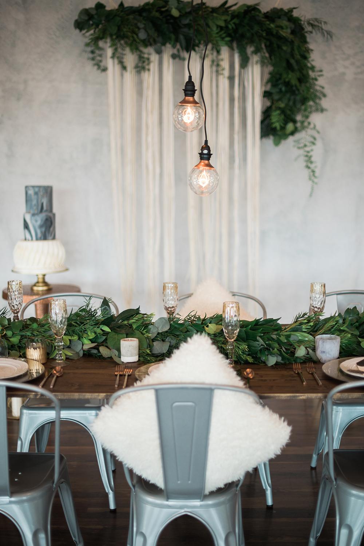 Edison bulb wedding decor - photo by Kristen Weaver Photography http://ruffledblog.com/modern-organic-wedding-inspiration-with-greenery