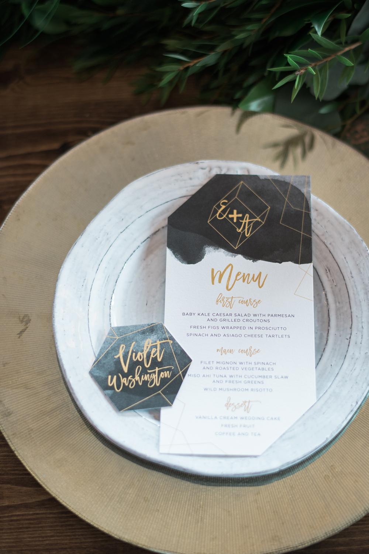 modern place settings - photo by Kristen Weaver Photography http://ruffledblog.com/modern-organic-wedding-inspiration-with-greenery