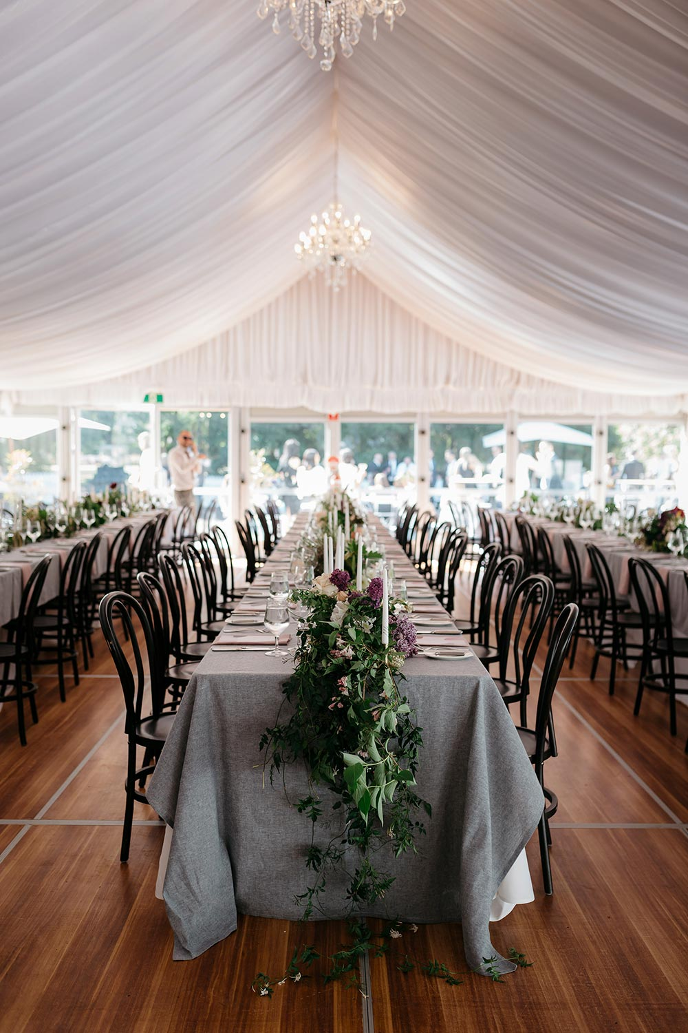 romantic wedding reception draping and family style tablescape with grey linens