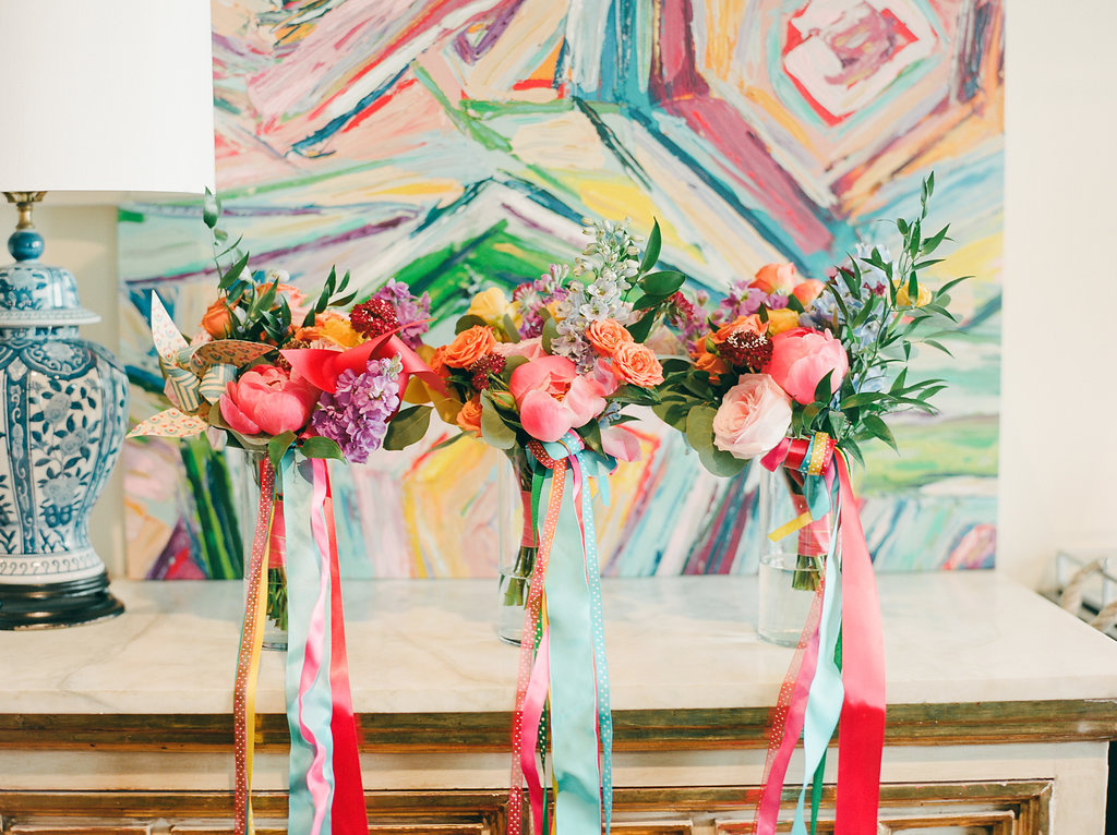 colorful bridesmaid bouquets - https://ruffledblog.com/modern-playful-texas-carnival-wedding