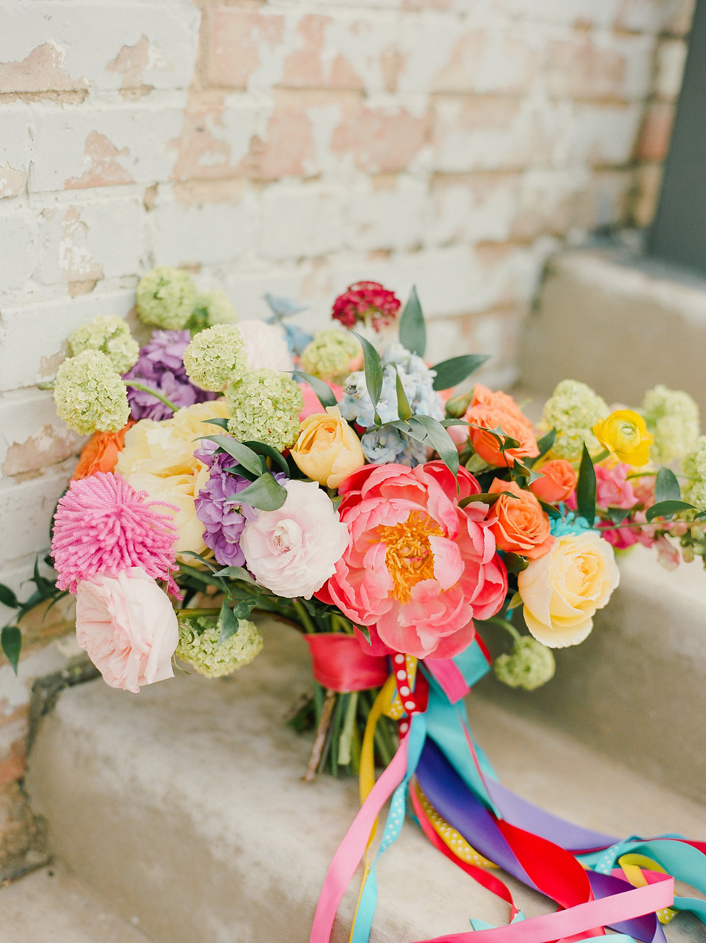 colorful spring wedding bouquets with coral charm peony - http://ruffledblog.com/modern-playful-texas-carnival-wedding