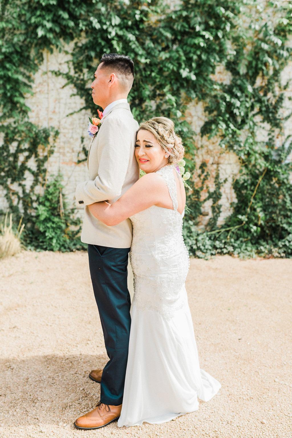 wedding first looks - https://ruffledblog.com/modern-playful-texas-carnival-wedding