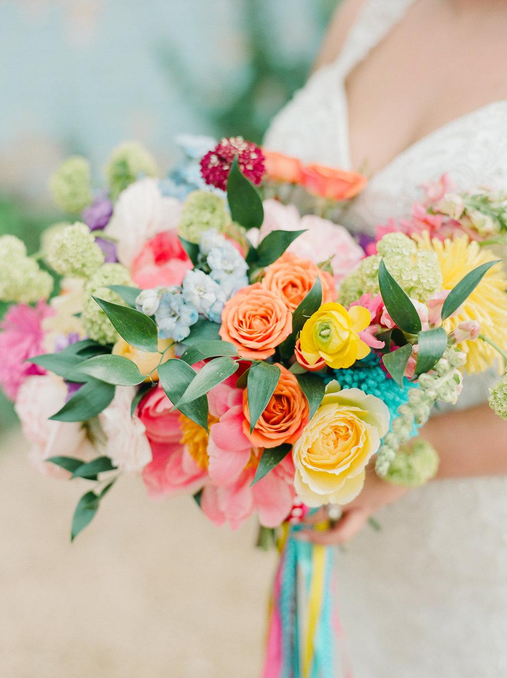 colorful spring wedding bouquets - https://ruffledblog.com/modern-playful-texas-carnival-wedding