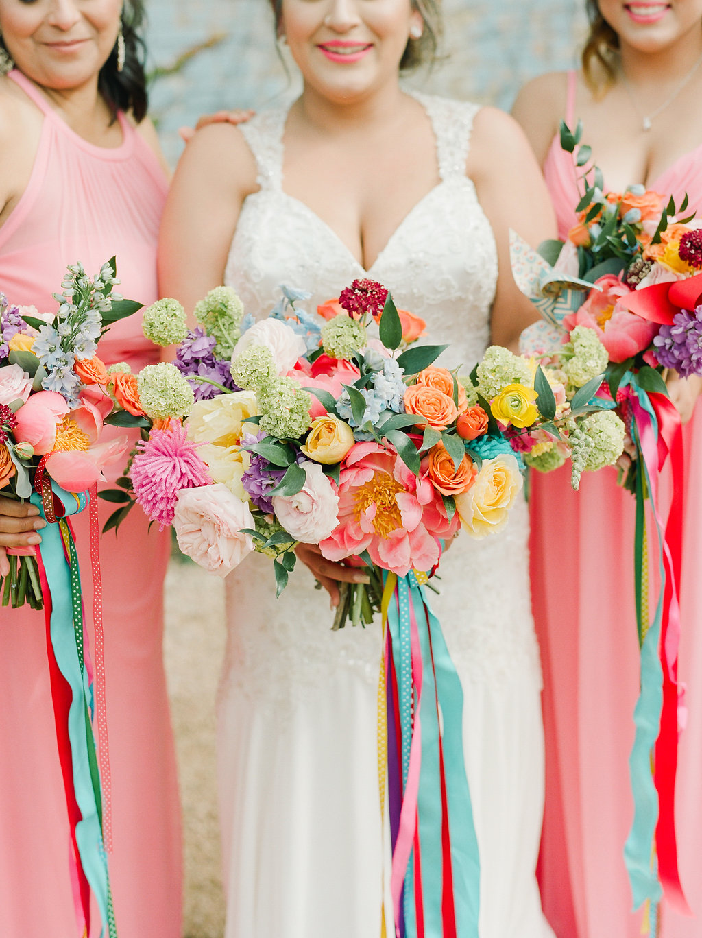colorful wedding bouquets with bright ribbons - https://ruffledblog.com/modern-playful-texas-carnival-wedding
