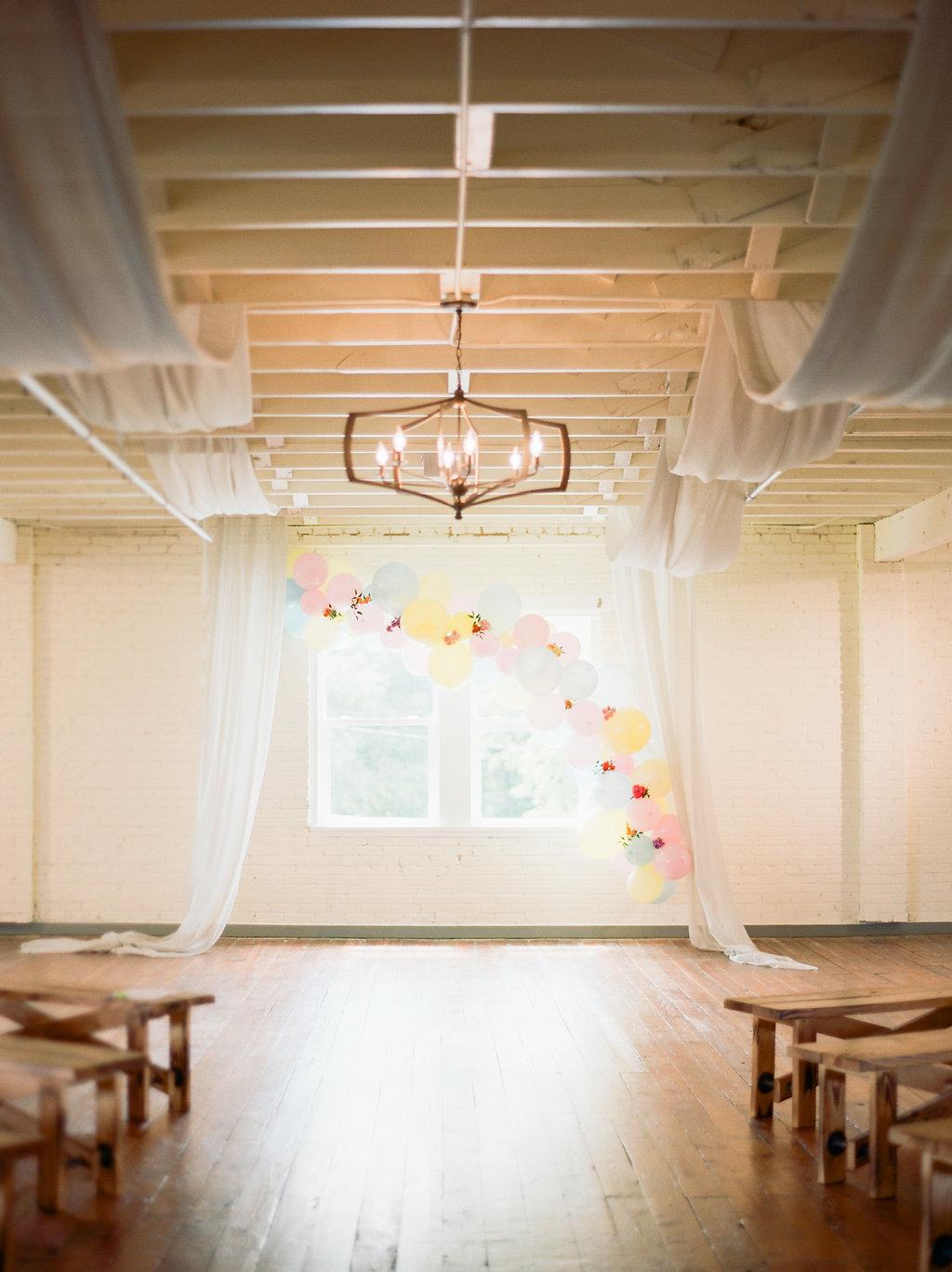 modern playful ceremonies - https://ruffledblog.com/modern-playful-texas-carnival-wedding