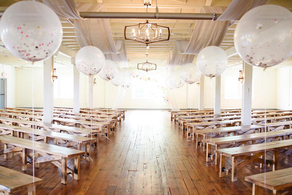 wedding ceremonies with balloons - https://ruffledblog.com/modern-playful-texas-carnival-wedding
