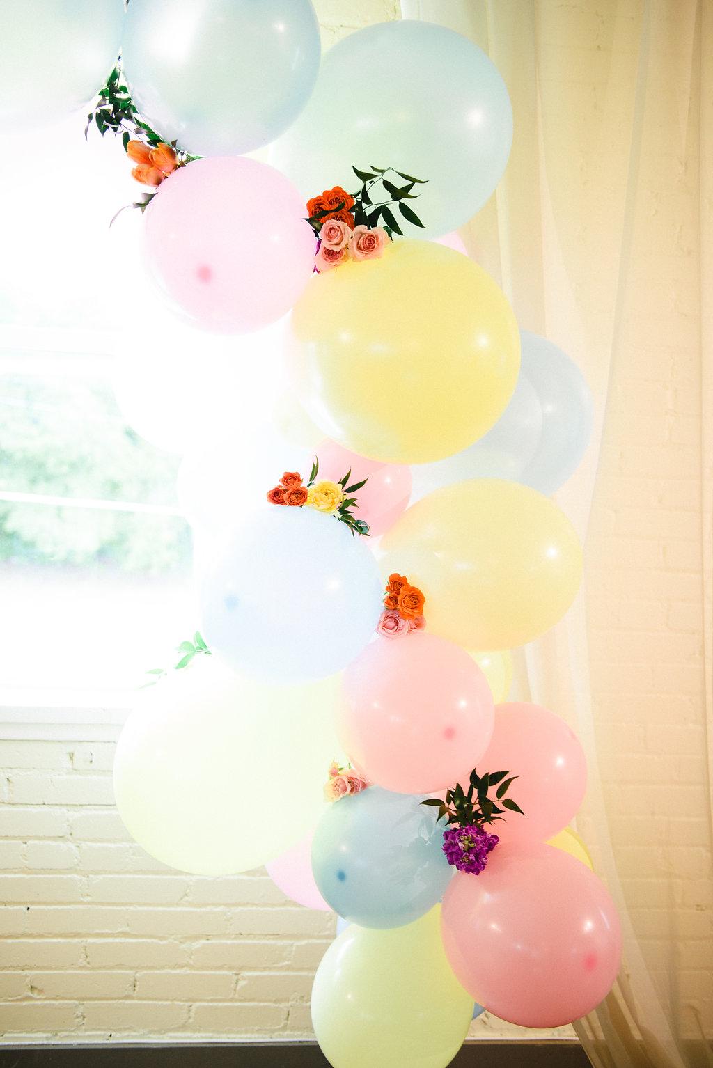 balloon ceremony displays - https://ruffledblog.com/modern-playful-texas-carnival-wedding