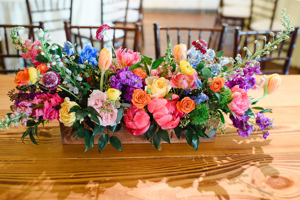 colorful wedding centerpieces - https://ruffledblog.com/modern-playful-texas-carnival-wedding