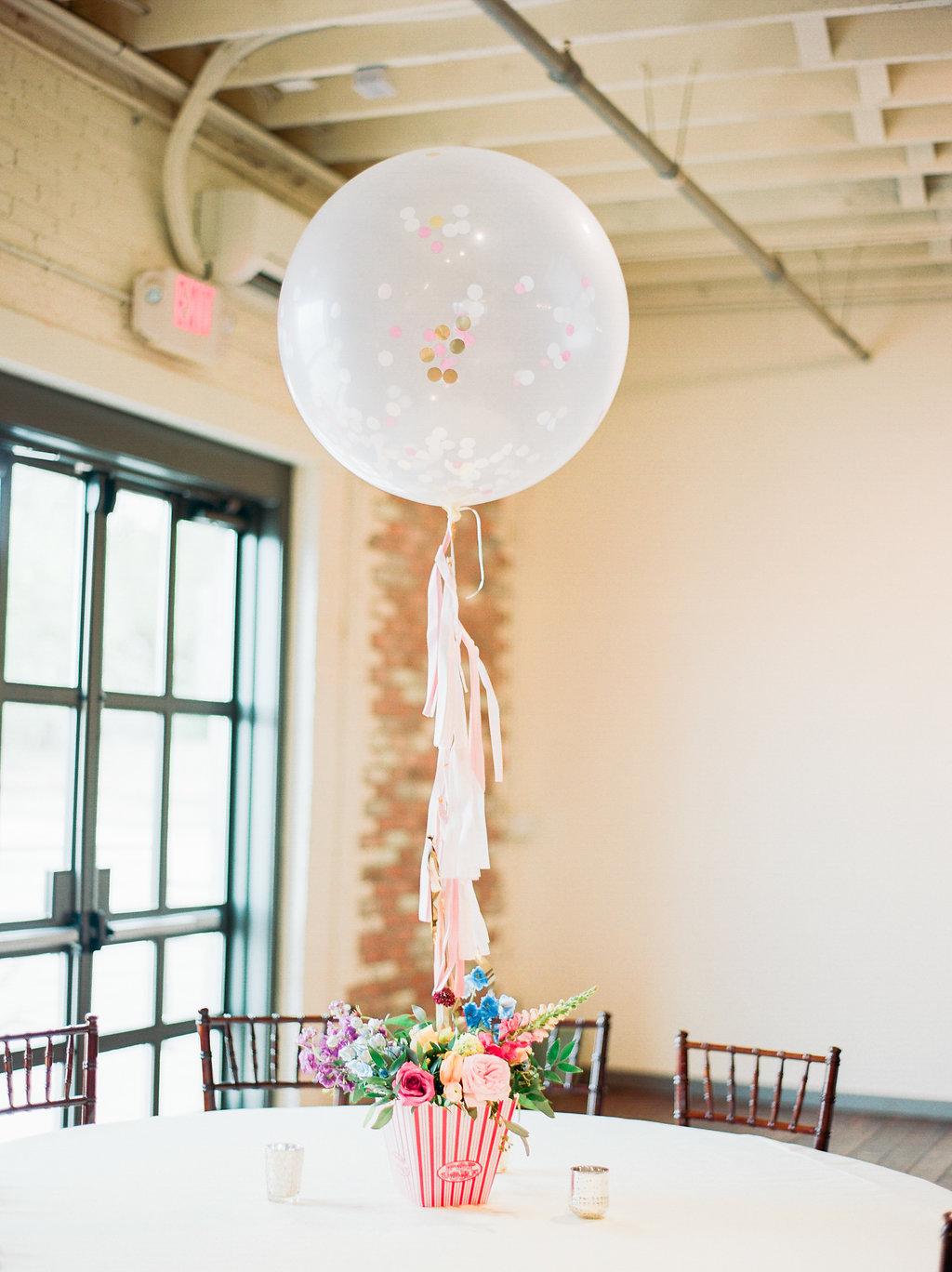 balloon centerpieces - https://ruffledblog.com/modern-playful-texas-carnival-wedding