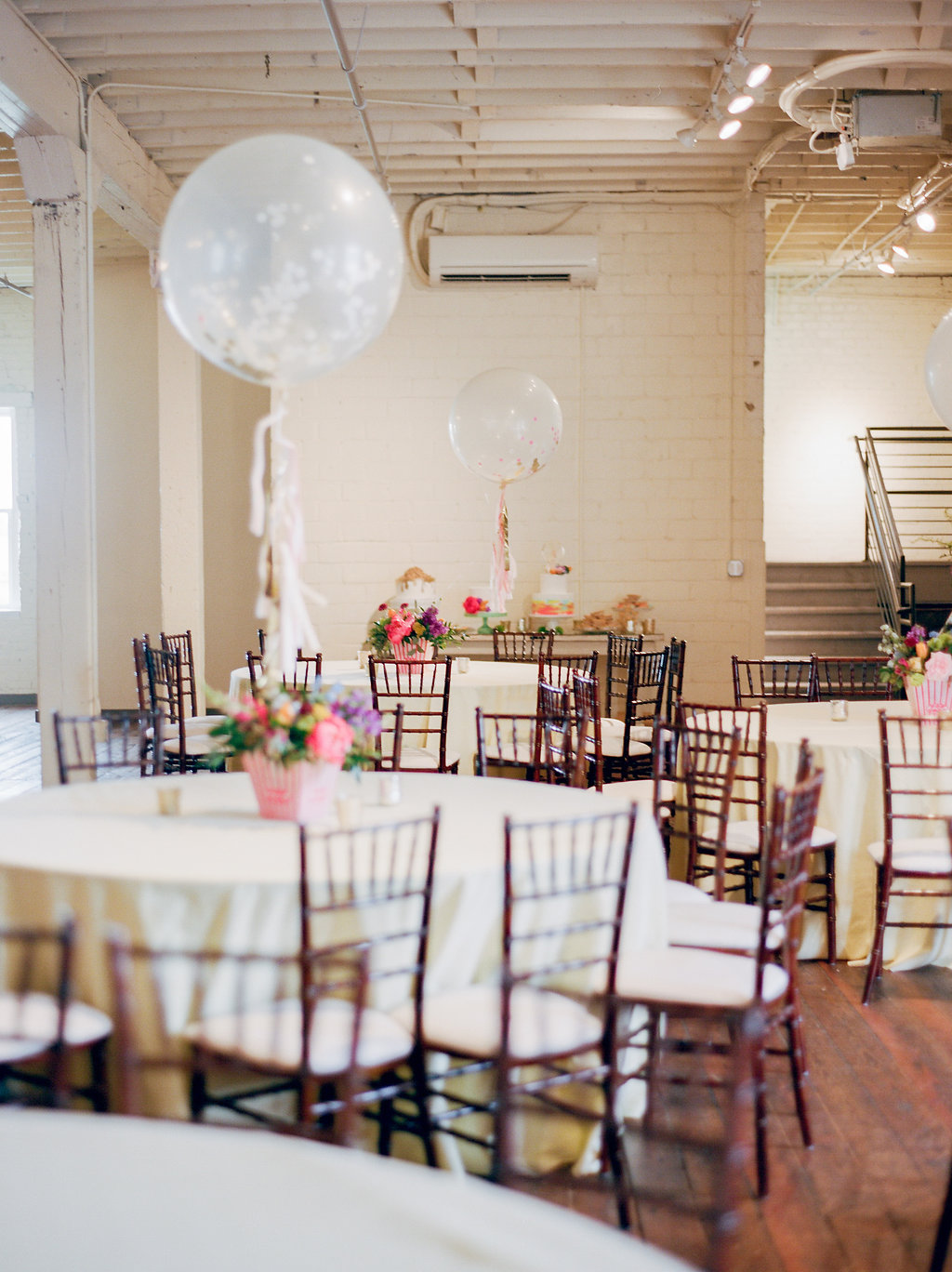 modern playful wedding ideas with balloons - https://ruffledblog.com/modern-playful-texas-carnival-wedding