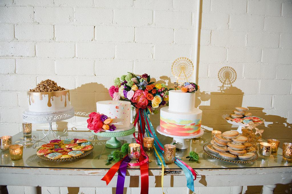 wedding cake tables - https://ruffledblog.com/modern-playful-texas-carnival-wedding