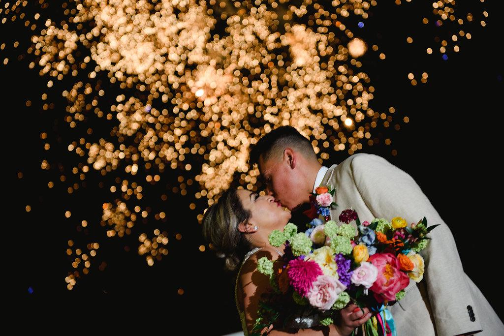 fireworks at weddings - https://ruffledblog.com/modern-playful-texas-carnival-wedding