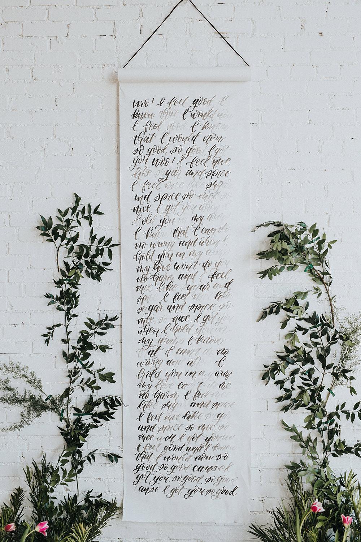 calligraphy banner backdrops - photo by Jacoby Photo and Design https://ruffledblog.com/modern-romantic-loft-wedding-inspiration