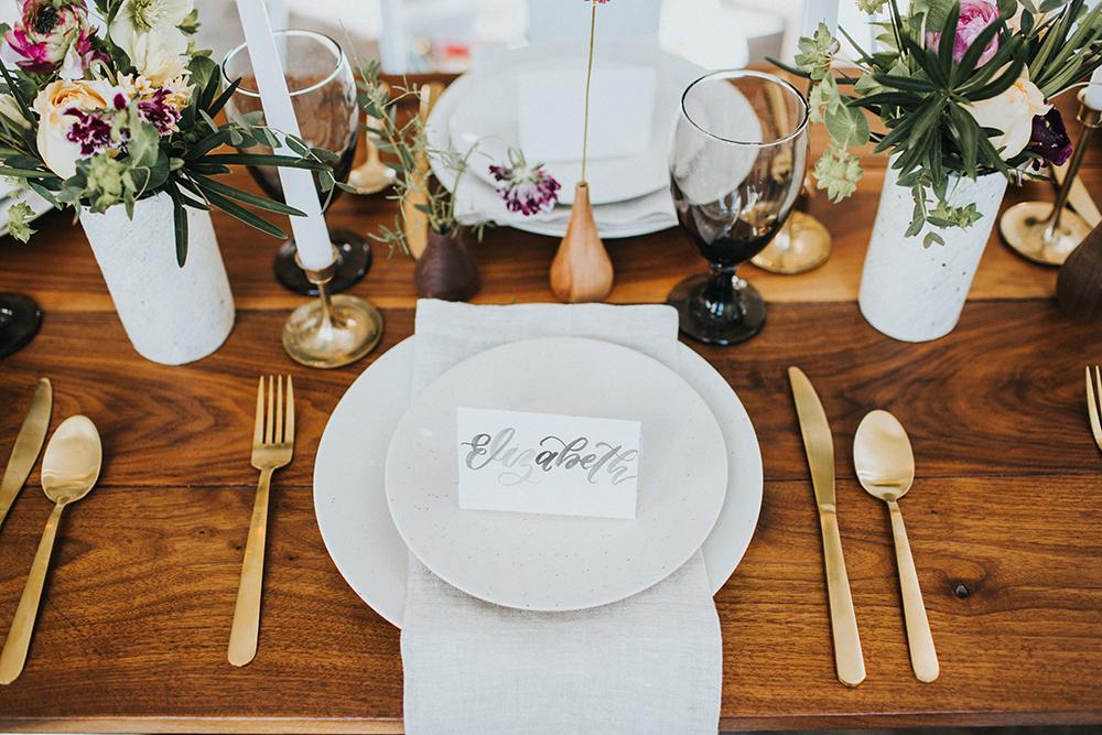 wedding place settings - photo by Jacoby Photo and Design https://ruffledblog.com/modern-romantic-loft-wedding-inspiration