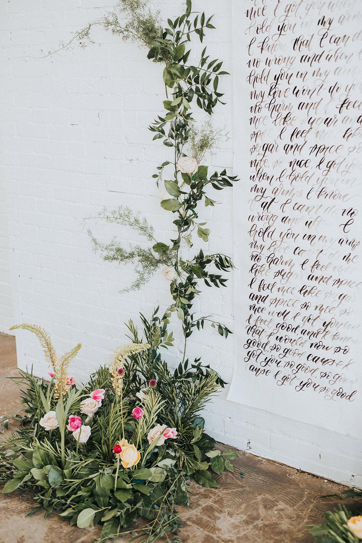 modern romantic wedding decor - photo by Jacoby Photo and Design https://ruffledblog.com/modern-romantic-loft-wedding-inspiration