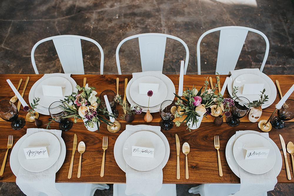 wedding tablescapes - photo by Jacoby Photo and Design https://ruffledblog.com/modern-romantic-loft-wedding-inspiration