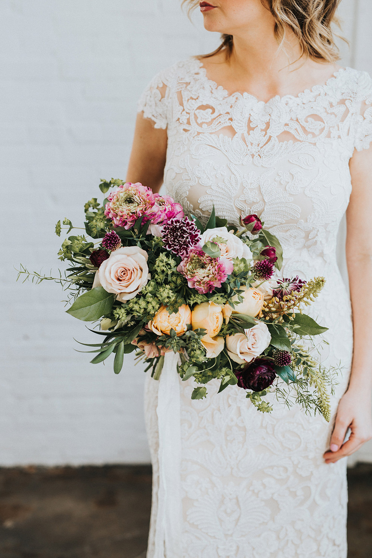 bouquet with purple - photo by Jacoby Photo and Design https://ruffledblog.com/modern-romantic-loft-wedding-inspiration