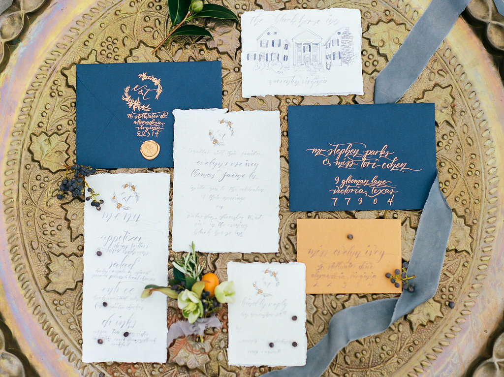 gold and blue wedding stationery - photo by Lissa Ryan Photography https://ruffledblog.com/modern-romantic-wedding-ideas-with-family-heirlooms