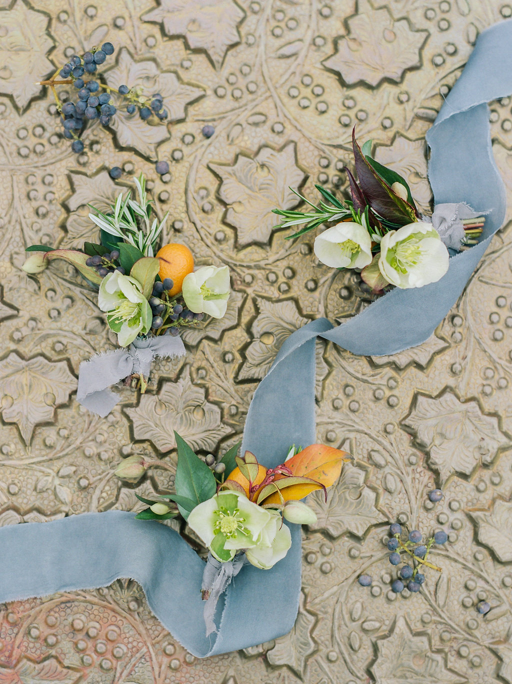 romantic orange boutonnieres - photo by Lissa Ryan Photography http://ruffledblog.com/modern-romantic-wedding-ideas-with-family-heirlooms