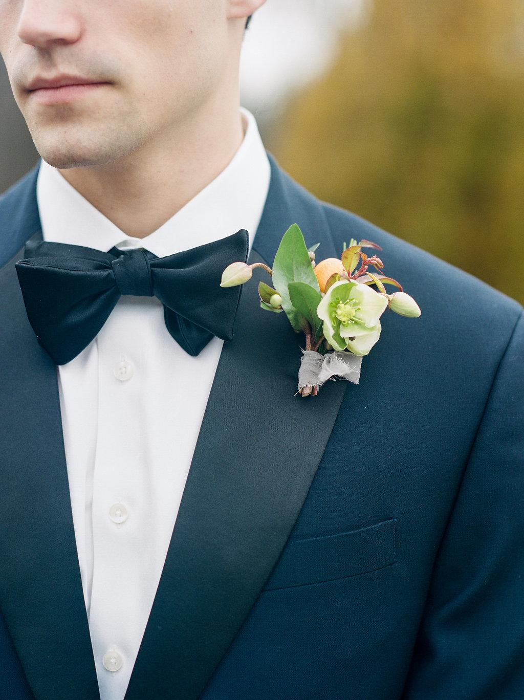 formal boutonniere ideas - photo by Lissa Ryan Photography http://ruffledblog.com/modern-romantic-wedding-ideas-with-family-heirlooms