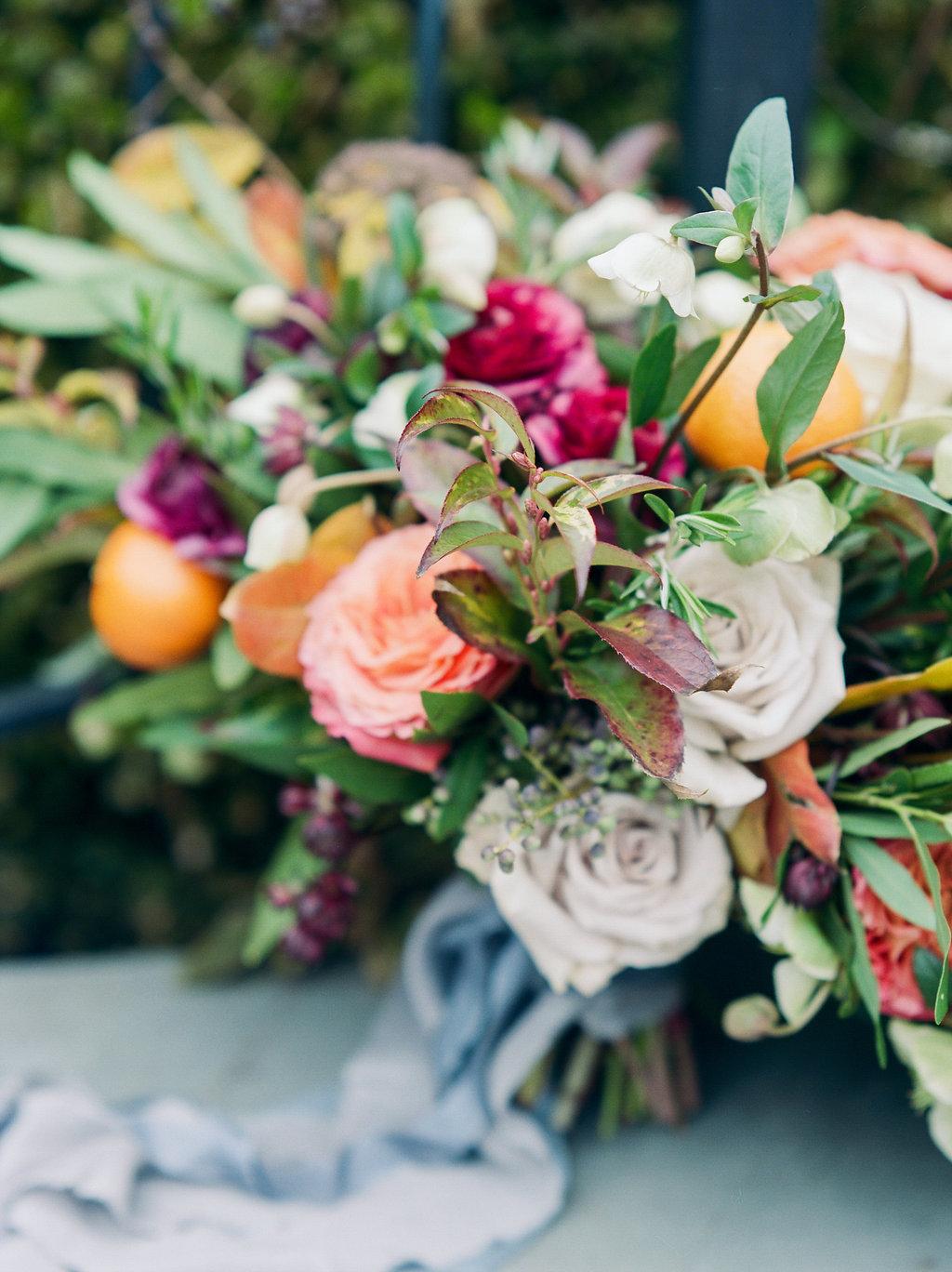 fall wedding flowers - photo by Lissa Ryan Photography http://ruffledblog.com/modern-romantic-wedding-ideas-with-family-heirlooms