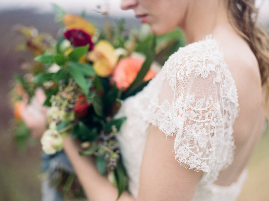bridal lace sleeves - photo by Lissa Ryan Photography http://ruffledblog.com/modern-romantic-wedding-ideas-with-family-heirlooms